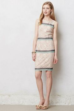 Maeve improves the standard lace sheath with rosegold material, delicate stripes and a pretty back cut-out.