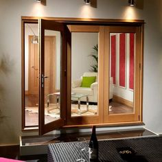 La Porte Vista 3 Door Oak Folding Door Set - Opens Right, Fully Decorated. #lifestyle #home #modernliving #oakdoor #directdoors