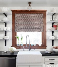 lovely window and shade against all the white tile.