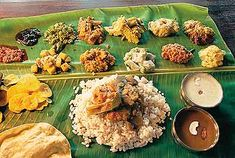 Traditional Kerala meal for the harvest festival called Onam.  Several of the items here are typical lunch side dishes.  It is traditionally served on a banana leaf and every food item has its own unique flavor.  It is also usually served for Hindu weddings in Kerala.