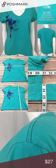 Size XL North Face Teal V-Neck Floral T-Shirt Top • Measurements are in photos  • Material tag is in photos • Normal wash wear, tiny snag hole on one shoulder, no other flaws • V-Neck  • Short Sleeves  • Floral Print  B1/66  Thank you for shopping my closet! The North Face Tops Tees - Short Sleeve