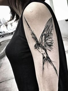 Inez Janiak bird tattoo