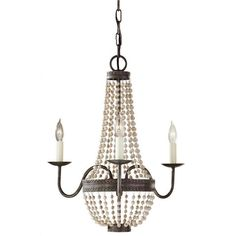 Embellish your favorite living space with the quaint sophistication of the Charlotte three-light chandelier. This effulgent fixture spotlights decorative wood accents and a stunning Peruvian bronze finish.