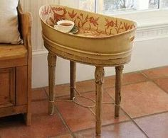 Washtub > side table...but it looks like a bassinet to me.