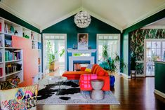 In This Self-Taught Designer's Prismatic Family Home, Hot Pink Is a Neutral Living Room Bookcase, My Living Room, Living Spaces, Best Interior, Interior Design, Interior Paint, Living In Italy, Bedroom Wall Colors