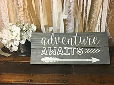 Adventure Awaits Sign, Adventure Sign, Woodland Nursery, Nursery Decor, Arrow Sign This Adventure Awaits sign is perfect for a wedding or baby shower gift. It would look great hanging in a nursery! What a great gift for all those outdoor adventure types; perfect for any adventure in your life! All our signs are made with naturally aged, distressed reclaimed wood. Pictured sign is stained with weathered grey, hand painted with white chalk paint lettering, and sealed so it will last for…