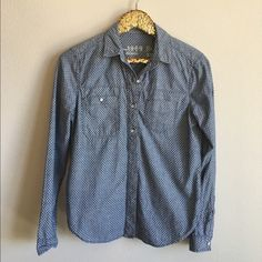 Polka Dot Chambray Top GAP button up chambray top. Gently used and no signs of wear or damage. 100% cotton. Full button up - buttons on the bottom are hidden. GAP Tops Button Down Shirts