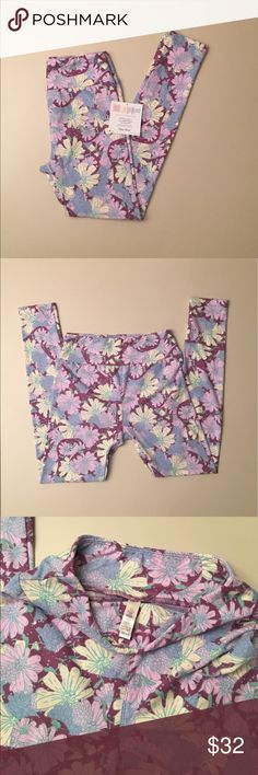 LuLaRoe Mommy and Me Pastel Floral Print Leggings These buttery soft leggings are from the Mommy and Me line, which means it's possible to find matching pairs in other sizes. They are also a little more expensive. Colors: soft, pale yellow; pale pink/almost lavender; periwinkle; light plum; flowers outlined and detailed in sea foam green, but mint green compliments quite nicely (see last photo). Brand new. Never worn or tried on. LuLaRoe Pants Leggings