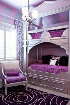 This is quite an interesting purple room with a two-storey bed in it