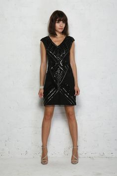Sequin Flapper Dress - For an alternative take on the LBD, we are so smitten with this black embellished flapper dress. With its loose fit, which rocks a hit of 1960s cool alongside its truly twenties roots, this smock style dress is made beautifully bling with the geometric embellished bodice set on a sophisticated sheer panel. This vintage style dress is the perfect mix of rich retro charm and contemporary detailing making it an easy win for party season. Make like a flapper girl and add…