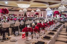 Long, rectangular tables were swathed in white or black lace linens and topped with alternating arrangements incorporating vibrant red roses. Sparkling chandeliers illuminated the ballroom. Photography: Yogi Patel - Global Photography. Read More: http://www.insideweddings.com/weddings/indian-wedding-with-vibrant-colors-and-gorgeous-red-roses/639/