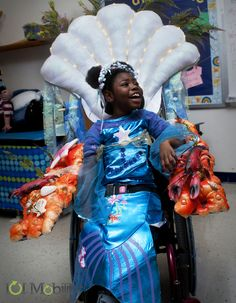 This mermaid wheelchair costume looks fabulous with a light up seashell and friendly sea creatures!