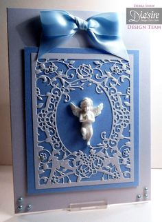 Debra Shaw US Create A Card Classic Floral Frame, White Centura Pearl, Blue Centura Pearl, Collall all purpose, Tacky glue, Ribbon, Pearls, Cherub.