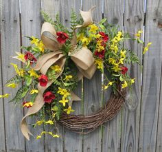 This beautiful red and yellow wreath is characterized by realistic forsythia, poppies, and fern. A wired burlap ribbon makes a simple bow. Spring Front Door Wreaths, Fall Wreaths, Floral Wreaths, Diy Wreath, Grapevine Wreath, Wreath Ideas, Forsythia Wreath, Tulle Wreath, Burlap Wreaths