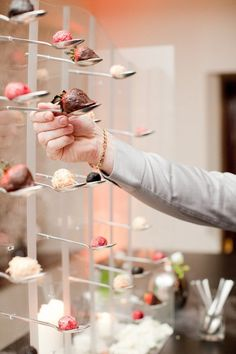 This unique bar is made of spoons filled with one bite of dessert! Can have a huge variety of options and guests can take more than one.  Candy + Dessert Tables || Aisle Perfect