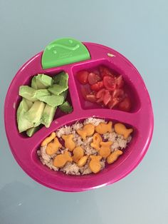 Avocado slices, chopped tomato, tuna salad and goldfish