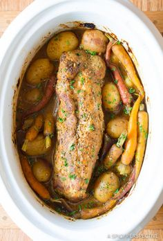 Crock Pot Pork Loin with Vegetables - an easy slow cooker pork loin recipe with potatoes, carrots, onions, and herbs in a rich tangy gravy. This crockpot