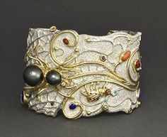 how beautiful if this cuff and I bet your won't find another in the room