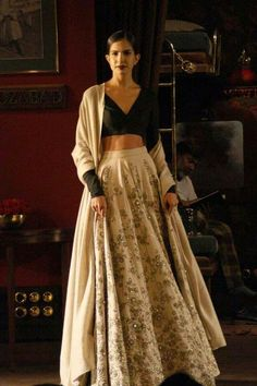 Sabyasachi India Couture Week 2014 - pure elegance. Love the on trend crop top with lightly embellished lehenga