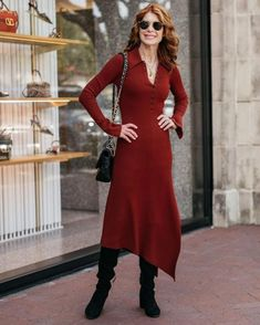 Ribbed midi dress, tall boots and sling bag | Photo shared by Cathy, @themiddlepageblog | For more style inspiration visit 40plusstyle.com