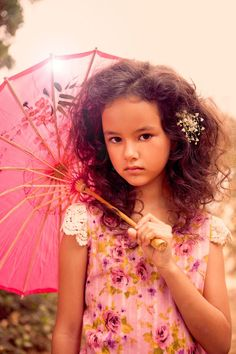 Girl with Pink parisol and flower dress