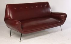 An Italian sofa with flared arms and resting on iron legs circa Ht: Width: Depth: on Feb 2015 Italian Sofa, Love Seat, Arms, Auction, Couch, Furniture, Home Decor, Settee, Decoration Home