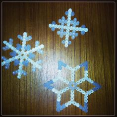 Perler bead snowflakes by mtilleniusj