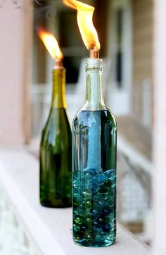 Wine bottle Tiki torches. www.ContainerWaterGardens.net