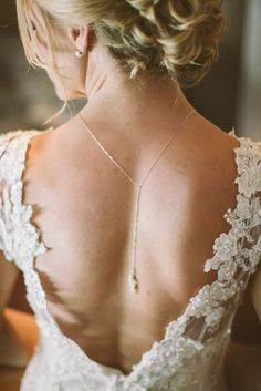 Open backed wedding dresses are hard to find. A full lace wedding dress is quite the find and we love how this bride styled it with her long pendant in the bacl.  When going backless, add detail and highlight by wearing your hair up like she did! Photos by Clane Gessel Photography | #weddings #weddingdresses #backlessweddingdress