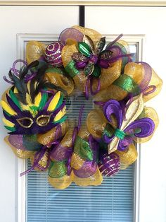 I need to learn how to make these cause $80 bucks, really???  Mardi Gras Wreath by SouthernWreathDesign on Etsy, $80.00