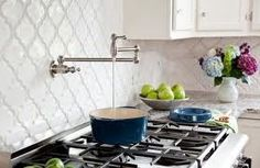 This glazed ceramic Beveled Arabesque tile is perfect for a shower accent tile. The Beveled Arabesque Tile has been featured on Apartment Therapy, and is an award winning tile selection. Moroccan Tile Backsplash, White Kitchen Backsplash, Backsplash Tile, Backsplash Ideas, Backsplash Arabesque, Kitchen Tiles, Kitchen White, Herringbone Backsplash, Moroccan Tiles