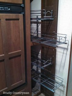 5 RV Pantry Cabinet Problems & Solutions Rev-a-shelf wire slide out baskets can help you reach the back of a deep kitchen pantry cabinet in your Slide Out Pantry, Pull Out Pantry, Slide Out Shelves, Sliding Shelves, Small Kitchen Pantry, Kitchen Pantry Design, Kitchen Pantry Cabinets, Kitchen Decor, Kitchen Ideas
