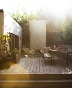 // modern wood deck, lounge chairs and outdoor fireplace