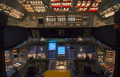 In Orbiter Processing Facility-2 at NASA's Kennedy Space Center in Florida, the flight deck of space shuttle Atlantis is illuminated one last time during preparations to power down Atlantis during Space Shuttle Program transition and retirement activities