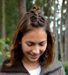 medium hairstyle with braided bangs