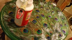 Decorate an Old Table -- Using Peacock Feathers https://fromadreamtodiy.blogspot.com/2016/08/trash-to-treasure-up-cycling-end-table.html