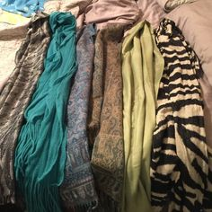 LOT OF 6 Scarves 6 super cute& cozy fall scarves! All of them are brand new, or worn once! Includes Left to Right:  shimmery zebra, sage green, green paisley/flowers, blue/grey with flowers, ruffled teal, and silver and black cheetah print! Accessories Scarves & Wraps