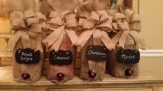 Barn Party... Bota Boxes wrapped in Burlap bags purchased from Tractor Supply Center...Burlap bows and chalkboard tags purchased at Hobby Lobby...cost less than $20 for all four...would love to see more ideas on dressing up boxed wines.