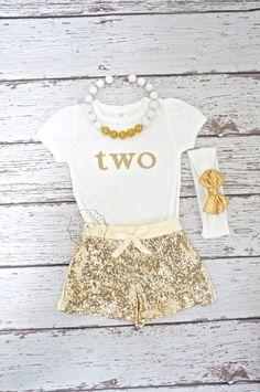 Glitter gold onesie- Babies first birthday- Gold Girls Birthday outfit- Glitter gold bodysuit- gold one onesie- 2nd birthday outfit- Girls by PoshPeanutKids on Etsy https://www.etsy.com/listing/217754832/glitter-gold-onesie-babies-first