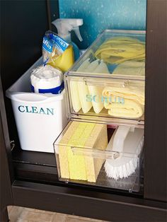 Organized under the sink using clear acrylic shoe boxes for storage.