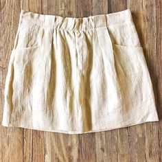 NWOT J. Crew shimmery gold linen miniskirt This neutral sand gold miniskirt adds a touch of glam in shimmery crinkled linen. It has front pockets, belt loops, a cotton lining and back zip and hook closure.  90% linen/ 10% nylon. 100% cotton lining. This skirt is brand new and gorgeous! J. Crew Skirts Mini