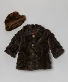 This layer of vintage-inspired style is made of soft faux fur with a hat to match. Its rich colors and pretty pattern create a charming and classic look.