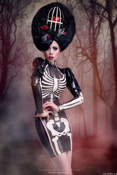 Westward Bound Skeleton Dress (Link: http://gothic.org/headline/westward-bound-skeleton-dress/) Get ready to drool over this jaw dropping dress by Miss Overdose at Westward Bound of the UK. Inspired by a visit to the Cappuccini Catacombs in Palermo, Sicily this dress features a cameo neck, coffin-shaped semi-transparent black latex front panel trimmed in latex and complete with white latex... - Gothic.org
