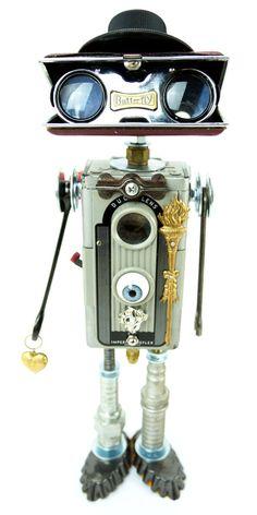 """Quantum Tarantino"" Height: 15"" Principal Components: Imperial Reflex camera, opera glasses, ham radio dial, doll eye, wrenches,..."