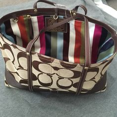 Coach handbag COACH logo handbag brand-new!!!! never been used.....not from the outlet Coach Bags