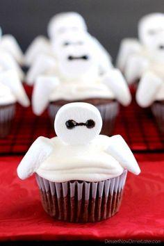 Use marshmallows to make fluffy cupcakes resembling Baymax from Big Hero 6.