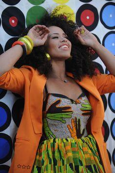 Ella Varner- Beautiful R singer wearing a kente paired with an Orange blazer.