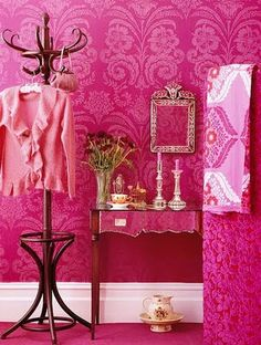 Fuchsia Walls. That color/wallpaper would be incredible in a huge closet.