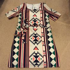 Tribal print shift dress Cute print, lined, short sleeved tie sash waist belt rear zip shift dress. Size medium on tag but runs like a small. Pit to pit measures 17 inches waist 17. Hips 19 Dresses