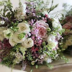 Pink and lavender summer bouquet. Sweet Avalanche Roses, mint, larkspur, spray roses, lisianthus, pink Gypsophila, Bouvardia